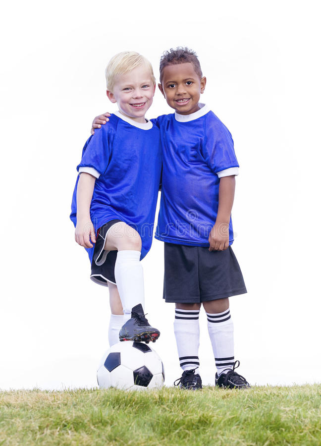two-diverse-young-soccer-players-white-background-full-length-view-youth-recreation-league-little-boys-standing-grass-51696161